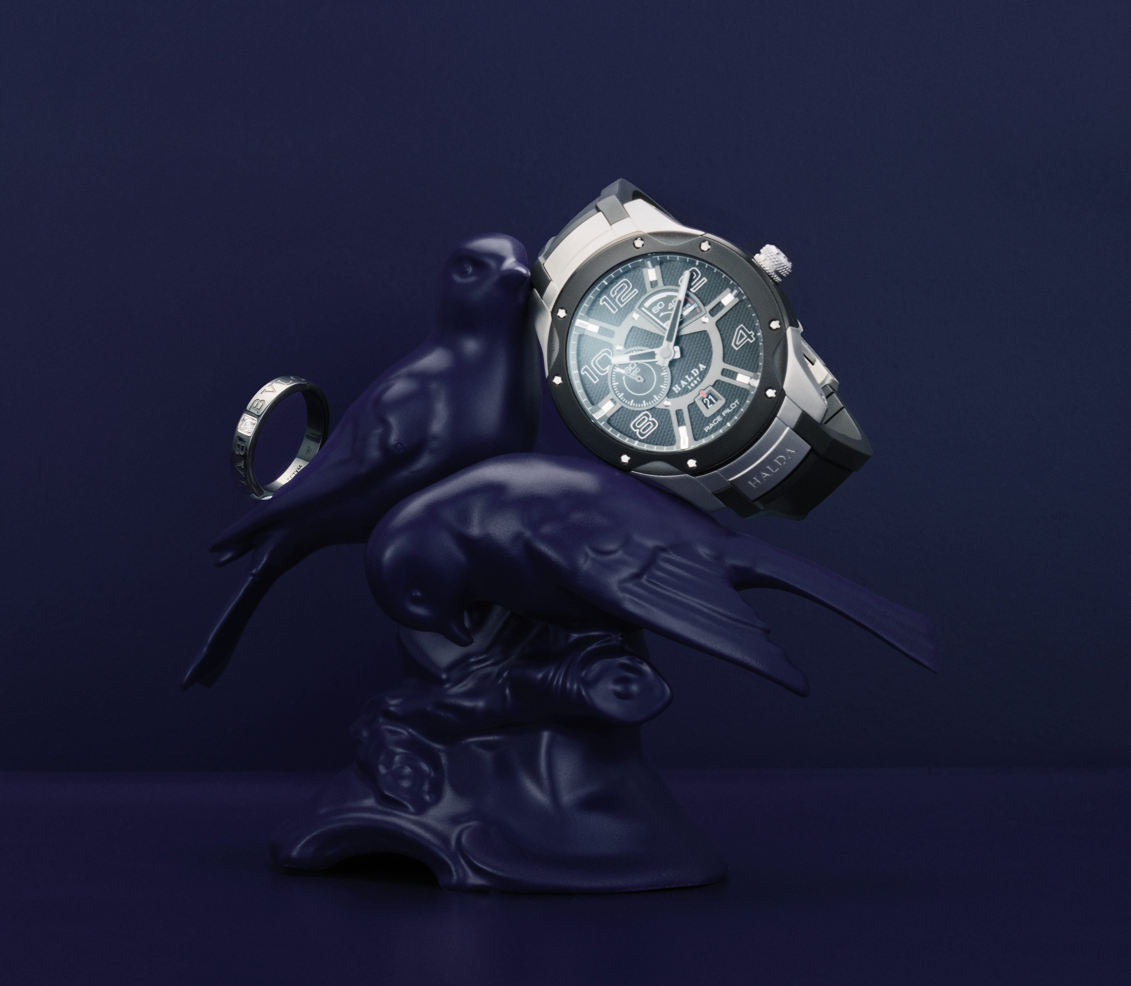 Halda Race Pilot RPM-3 with analog  and digital faces and a Zenith movement,  price app. 13,400 USD, Nymans Ur 1851. Ring from Bvlgari in ceramic  with diamond, 0,20 ct,  price app. 1,400 USD, Bo Berggren Urhandel.