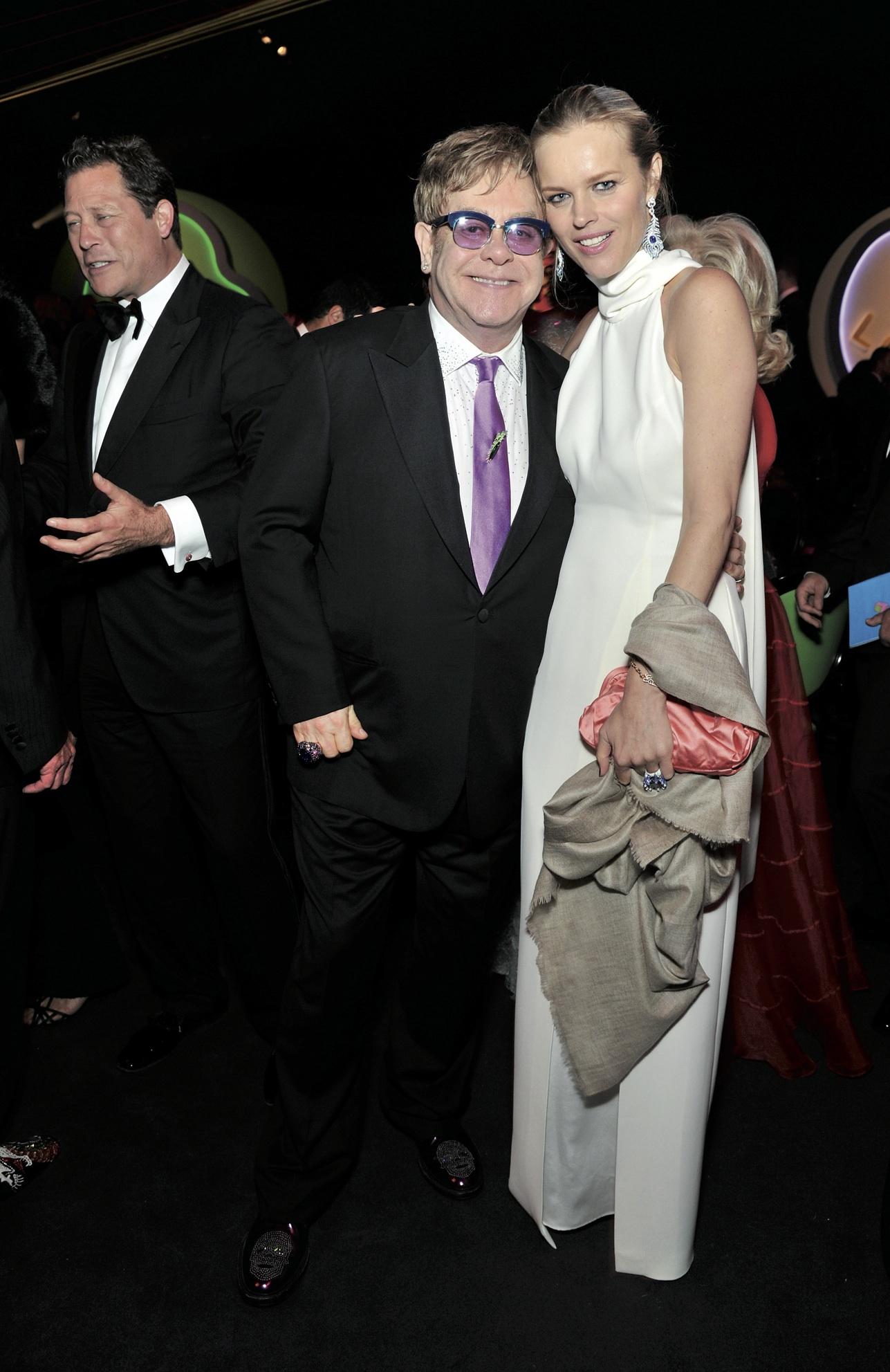 Sir Elton John and Eva Herzigova in Chopard.